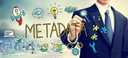 metadata:  Businessman drawing Metadata concept above the city