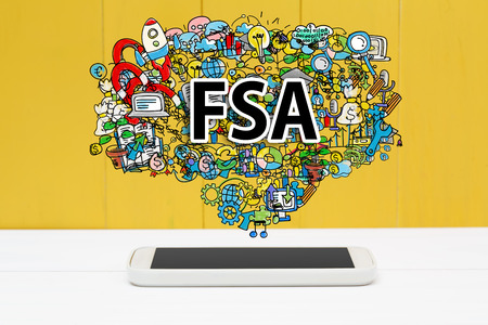 flexible business: FSA concept with smartphone on yellow wooden background Stock Photo