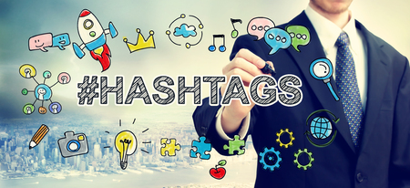 web marketing:  Businessman drawing Hashtags concept concept above the city