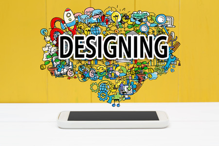 designing: Designing concept with smartphone on yellow wooden background