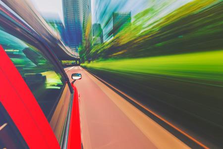 drive through: Motion blurred drive through the city via taxi cab Stock Photo