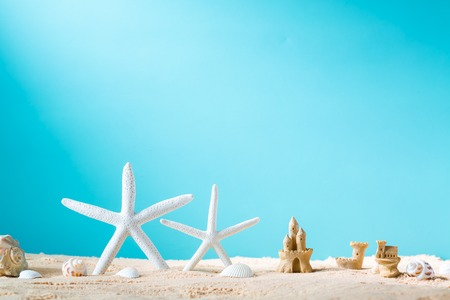 sand castle: Summer theme with starfish and sand castle in the sand Stock Photo