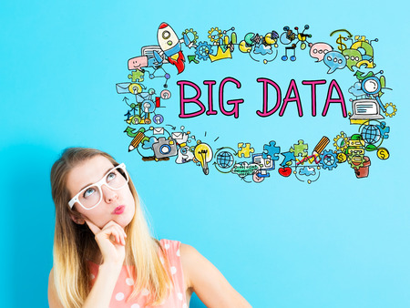 big woman: Big Data concept with young woman on blue background Stock Photo