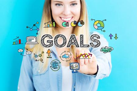 青の背景に若い女性との目標概念