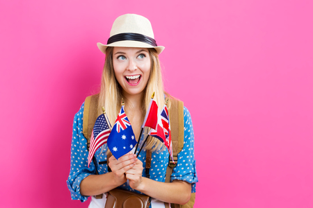 Young woman with flags of English speaking countries Stock Photo