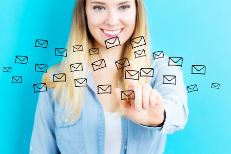 Email concept with young woman on blue background