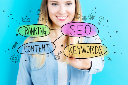 keywords bubble: SEO concept with young woman on blue background
