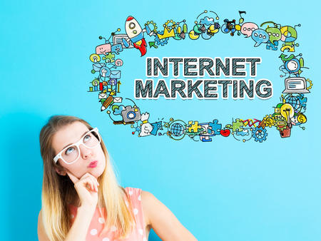 social networking: Internet Marketing concept with young woman in a thoughtful pose Stock Photo