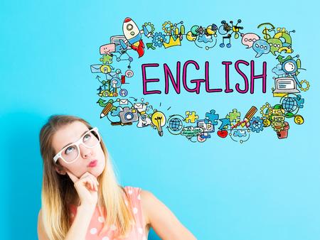 파란색 배경에 젊은 여자와 영어 개념