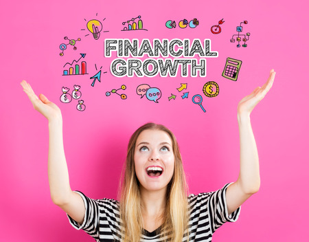 Financial Growth concept with young woman reaching and looking upwards