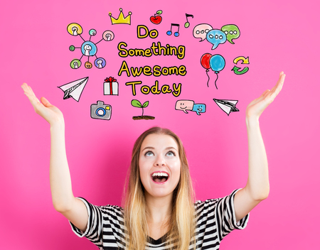 small business woman: Do Something Awesome Today concept with young woman reaching and looking upwards Stock Photo