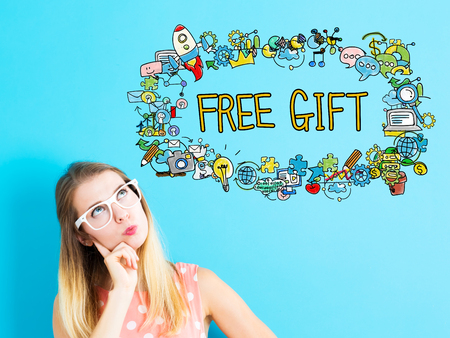 Free Gift concept with young woman on blue background Stok Fotoğraf