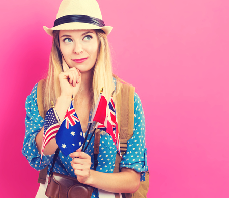 england: Young woman with flags of English speaking countries Stock Photo