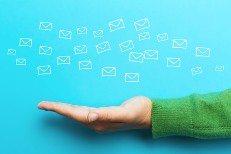 email: Email concept with hand on blue background Stock Photo