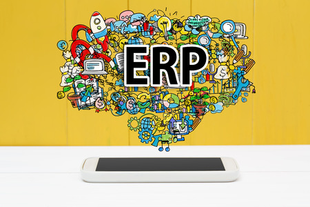 erp: ERP concept with smartphone on yellow wooden background