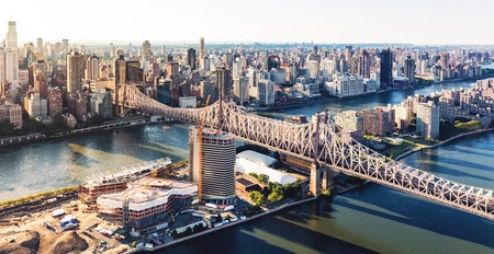 queens: Aerial view of the Ed Koch Queensboro Bridge over the East River in New York City