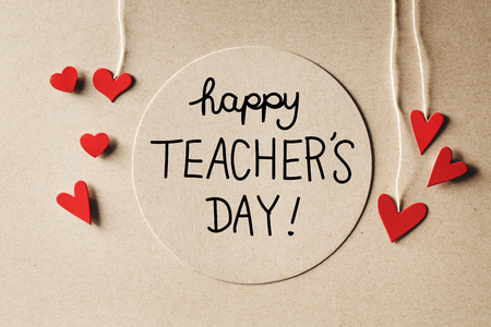 Happy Teachers Day message with handmade small paper hearts Фото со стока - 60901785