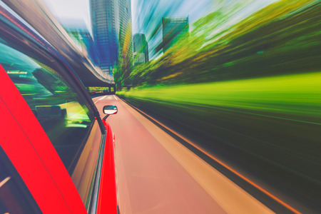 manic: Motion blurred drive through the city via taxi cab Stock Photo