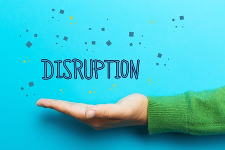 disruption: Disruption concept with hand on blue background Stock Photo