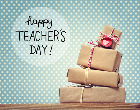 Teachers Day message with stack of gift boxes