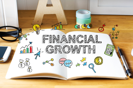 financial growth: Financial Growth concept with notebook on wooden desk