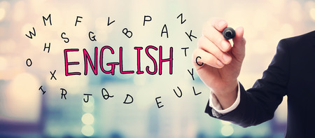 learn english: English concept with businessman on blurred abstract background