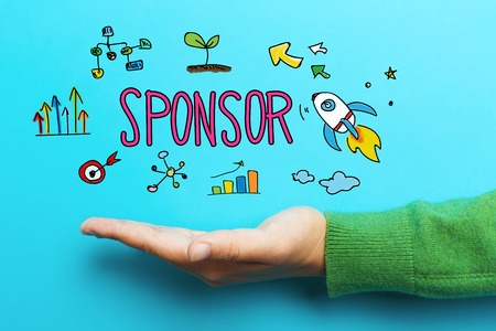 Sponsor concept with hand on blue background Stock Photo