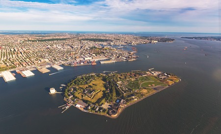 islands: Aerial view of the Governors Island with Brooklyn New York in the background