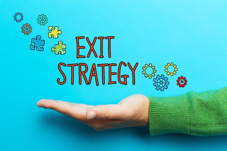 downsizing: Exit Strategy concept with hand on blue background