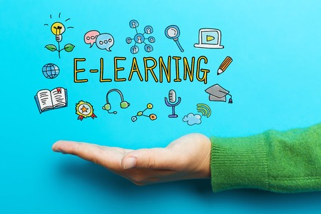 E-Learning concept with hand on blue background Stock Photo
