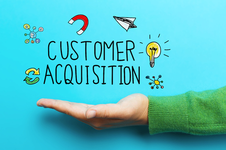 Customer Acquisition concept with hand on vivid blue background Stock Photo