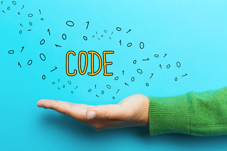 css: Code concept with hand on blue background Stock Photo