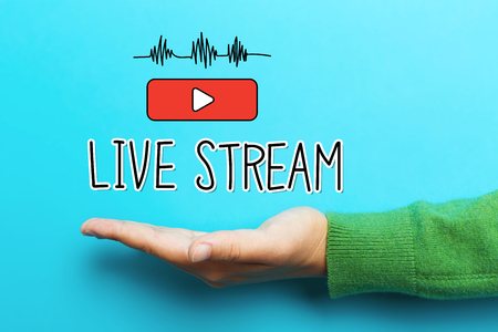 stream: Live Stream concept with hand on blue background Stock Photo