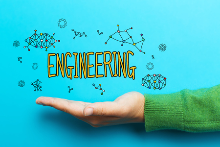 engineering drawing: Engineering concept with hand on blue background Stock Photo