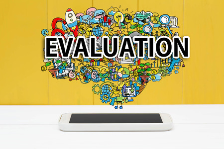 many: Evaluation concept with smartphone on yellow wooden background