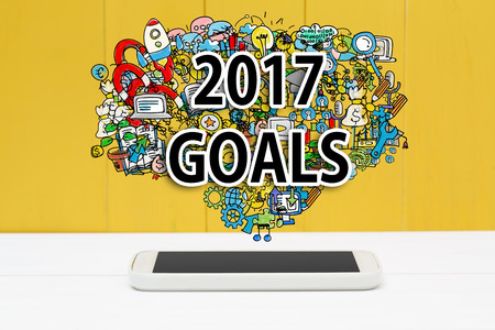 2017 Goals concept with smartphone on yellow wooden background