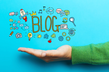 Blog with hand on blue background