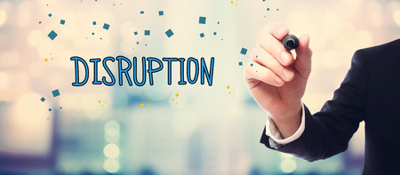 disruption: Businessman drawing Disruption concept on blurred abstract background