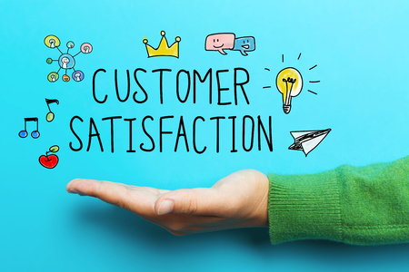 multiple targets: Customer Satisfaction concept with hand on blue background