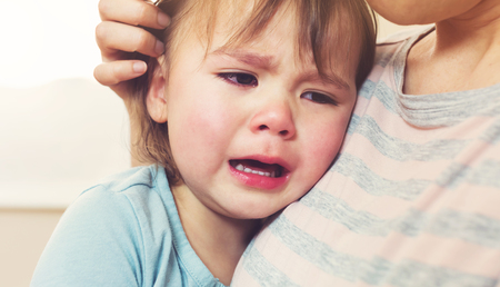 cry: Crying toddler girl being consoled by her mother