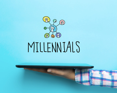 Millennials concept with a tablet on blue background Stock Photo