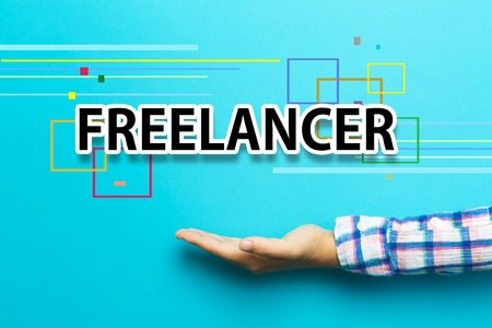 Freelancer concept with hand on blue background Stock Photo