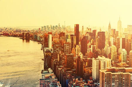 Aerial view of the New York City skyline near Midtown at sunset