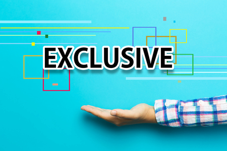 exclusive: Exclusive concept with hand on blue background