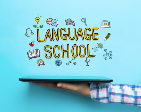 Language School concept with a tablet on blue background