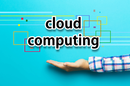 Cloud Computing concept with hand on blue background