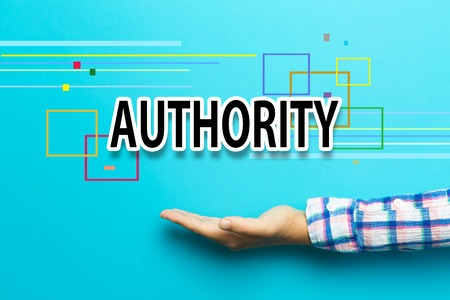 authority: Authority concept with hand on blue background