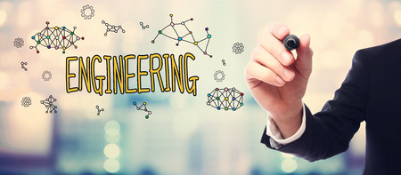 engineering: Businessman drawing Engineering concept on blurred abstract background