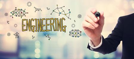 concetto Uomo d'affari disegno di ingegneria su sfondo sfocato astratto