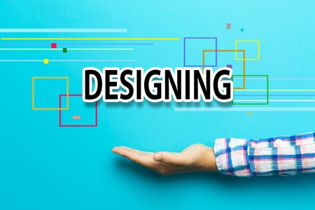designing: Designing concept with hand on blue background Stock Photo